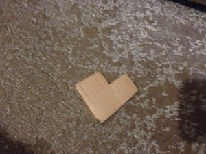 cardboard heart on garage floor
