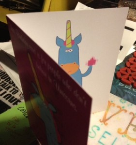 "the front of the card says ""this birthday card is for people who don't believe in Unicorns""  tee-hee"