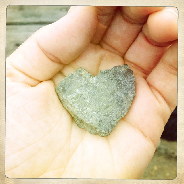 Heart shaped stone in hand